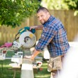 Manual Worker Cutting Wood Using Table Saw At Site — Stock Photo