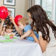 Stock Photo: Family Celebrating Son's Birthday At Home