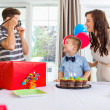 Stock Photo: Father Taking Picture Of Birthday Boy And Woman