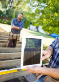Cropped Image Of Carpenter Holding Digital Tablet At Site — Stock Photo