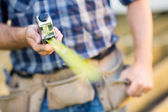 Cropped Image Of Carpenter Holding Tape Measure — Stock Photo