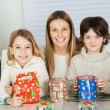 Happy Woman And Children With Christmas Gifts — Stok fotoğraf