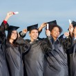 Students Holding Certificates Against Sky — Stock Photo #34274977