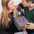 Couple With Christmas Presents Looking At Each Other — Stock Photo