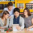 Students With Digital Tablet Studying Together In College Librar — Stock Photo