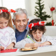 Man Looking At Children Making Christmas Greeting Card — Stock Photo