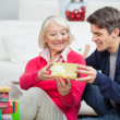 Son Giving Christmas Gift To Mother — Stock Photo