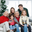 Family With Christmas Present In House — Stock Photo