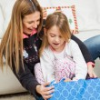 Mother And Girl Opening Christmas Present — Stock Photo #34275741