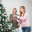 Happy Father And Daughter Decorating Christmas Tree — Stock Photo