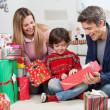 Parents Giving Christmas Present To Son — Stock Photo