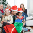 Stock Photo: Father And Children With Presents During Christmas