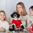 Family With Pet Dog At Home During Christmas — Stock Photo