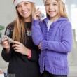 Mother And Daughter Decorating Christmas Tree — Stock Photo