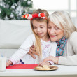 Grandmother Assisting Girl In Writing Letter To Santa Claus — Stock Photo
