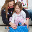 Mother And Daughter Opening Christmas Present — Stock Photo