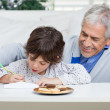Grandfather Assisting Boy In Writing Letter To Santa Claus — Stock Photo