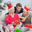 Foto Stock: Happy Parents And Son With Christmas Presents