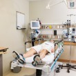 Stock Photo: Patient Lying On Bed In Hospital Room
