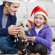 Girl With Father Holding Christmas Ornaments — Stock Photo