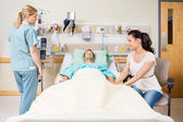 Woman Holding Patient's Hand In Hospital Room — Stock Photo