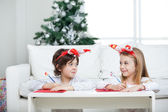 Siblings Writing Letter To Santa Claus During Christmas — Stock Photo