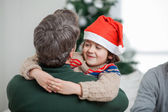 Son Embracing Father During Christmas — Stock Photo