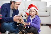 Girl With Father Holding Christmas Ornaments — Foto Stock