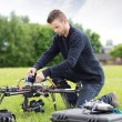 Stock Photo: Young Engineer Assembling UAV