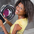 Woman Holding Digital Tablet Sitting At Laundromat — Stock Photo