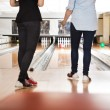 Female Friends Bowling in Club — Stock Photo