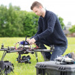 Stock Photo: Engineer Preparing Surveillance Drone in Park