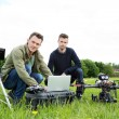 Engineers Using Laptop By UAV Helicopter — Stock Photo