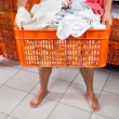 Stock Photo: Semi Nude MCarrying Basket In Laundry