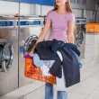 Woman Holding Basket Full Of Dirty Clothes — Stock Photo