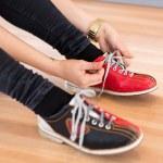 Woman Tying Shoe Lace in Club — Stock Photo