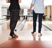 Female Friends Bowling in Club — Foto Stock