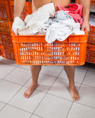 Semi Nude Man Carrying Basket In Laundry — Stock Photo