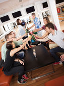Friends Toasting Drinks in Bowling Club — Stock Photo