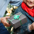 Man Giving Christmas Present To Woman At Store — Stock Photo