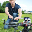 Stock Photo: Engineer Fixing Propeller Of UAV Spy Drone
