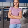 Beautiful Woman Standing Arms Crossed In Laundry — Stock Photo #34403289