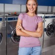 Stock Photo: Beautiful Woman Standing Arms Crossed In Laundry