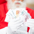 Santa Claus Holding Money — Stock Photo