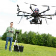 Technician Flying UAV Octocopter in Park — Stock Photo