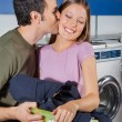 MKissing WomOn Cheek At Laundromat — Stock Photo #34409077