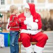Boy Giving Wish List To SantClaus — Stock Photo #34410067