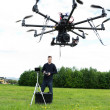 Male Technician Flying UAV Octocopter — Stock Photo