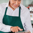Owner Using Digital Tablet In Grocery Store — Stock Photo