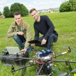 Technicians With Laptop And Digital Tablet By UAV — Stock Photo